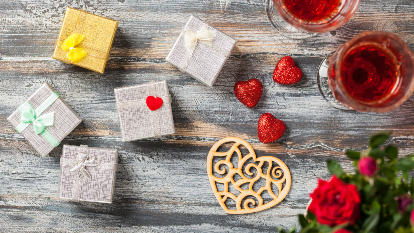 Picture shows gifts and wine to celebrate Valentine's Day. The blog post is about Practicing Self-Care on Valentine's Day on a Budget
